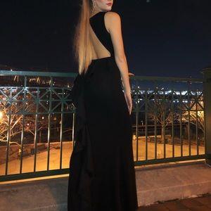 Formal full-length black-tie dress.